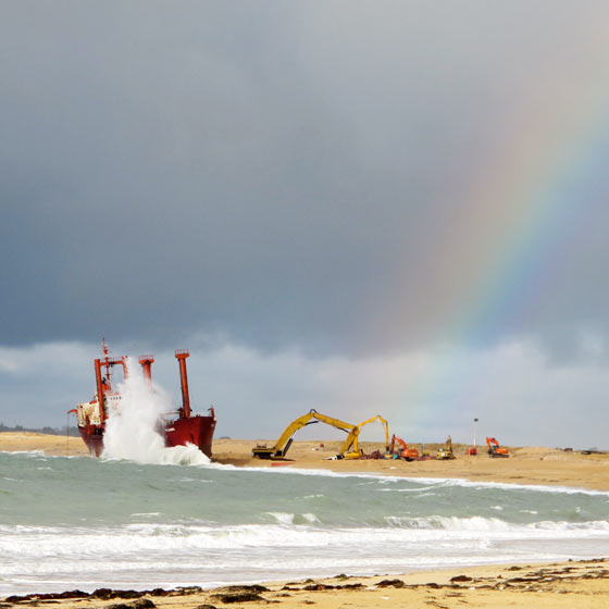 Florence Boudet - FLO-FLO - brittany - rainbow - storm - cargo ship - beached - beach - shore - wave - sea - december - crane - dismantle - impressive - cloud - grey - sun