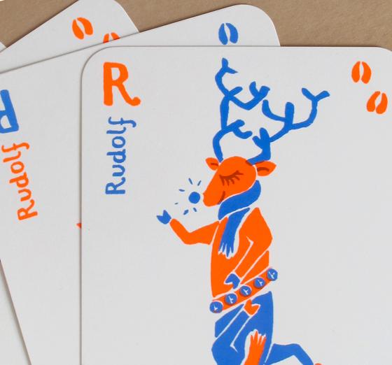 Cartes atouts de noël aux bords arrondis sérigraphiés en deux passages couleurs : renne Rudolf ©Florence Boudet
